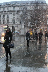 Snow shower (ireniclife) Tags: street trees woman snow bus london wet weather pavement odt