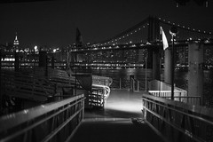 Ferry Landing at Brooklyn Bridge Park, Bargemusic.. (RobNYCity) Tags: city nyc newyorkcity bridge blackandwhite water skyline night river dark 50mm lights pier dock lowlight nikon pretty manhattan f14 14 east brooklynbridge eastriver handheld empirestatebuilding gotham highiso fultonferry nycity pier1 bargemusic ferrylanding brooklynbridgepark kingscounty 50g iso4000 4000iso robnycity