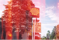 Shell station in Dreamland, 2005 (STUDIOZ7) Tags: distortion sign wisconsin surrealism shell gasstation artsy oil service 1970s 1980s wi chippewafalls petroliana