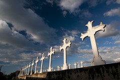 The Cross Section (puting bagwis) Tags: sunset sky white cemetery grave clouds cross wideangle christian sunsetlight sacrifice linear holyweek lowperspective gravemarker putingbagwis aaronsalazar