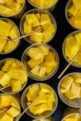 Abstract Bright Yellow Pineapple Fruit in Cups (HunterBliss) Tags: abstract aerial birds bright celebration clear color contrast cups cut depth down europe european eye fair field flourescent food fresh fromabove fruit german germany good juice juicy local mouth organic party pineapple pineappleonastick plastic row sticks time top translucent vacation yellow