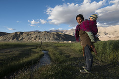 At Hanle (Ravikanth K) Tags: 500px hanle ladakh lady women farm mountains green fields clouds leh kid baby carrying mother outdoor water grass greenary india jammuandkashmir