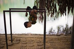 Dhaka, 2016. (rahat_kabeer) Tags: hanging workout baby tree lake dhanmondi dhaka bangladesh 2016 morning streetboy street photography portrait streetportrait lakeside canon eos canon6d 50mm f18 manual streetlife lifeinaframe color conceptual monkey predictade water root shadow reflection funny