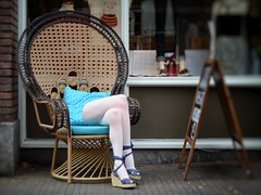 Crossed legs.. (frankvanroon) Tags: crossed legs street photography fun chair store delft woman nikon d7000