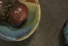 Purple calabash Tomato in small multicolored bowl (karenchristine552) Tags: ceramics clay gardening pennsylvania philadelphia pottery purplecalabash tomatoes universitycity westphiladelphia