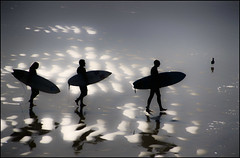Walking on Clouds (Steve Corey) Tags: ca clouds surfing sparkle surfers pismobeach wetsand threeisacrowd