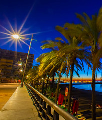Lightbursts (Steve-h) Tags: longexposure blue light red vacation espaa orange white holiday signs man black green art tourism beach sign metal wall sunrise canon fence dark palms eos dawn lights design vanishingpoint spain iron europe apartments sh
