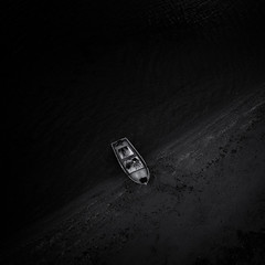 (windrides) Tags: black beach pen boat olympus aerial greece epm1