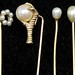 1035. Four Gold and Pearl Set Stickpins