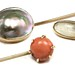 1038. Three Gold and Gem Set Stickpins