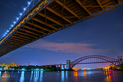 Night in the City (SunnyDazzled) Tags: city nyc longexposure nightphotography railroad bridge sky newyork water night reflections river stars lights cityscape queens transportation astoriapark triboro hellgate triborough robertfkennedy takenin3layers