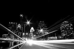 Austin skyline (BillyPixel) Tags: city bridge light urban blackandwhite bw skyline night skyscraper austin lights blackwhite timelapse downtown texas nightlights skyscrapers tx streetphotography nighttime capitol lighttrails nightlife statecapitol southcongress atx frosttower congressbridge top20texas