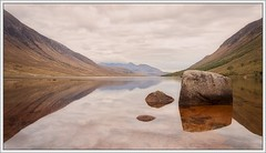 Loch Etive (ShinyPhotoScotland) Tags: light colour reflection art nature water composite manipulated landscape scotland highlands rocks warm emotion stones curves gimp places symmetry zen dreamy serene colourful loch geology areas awe toned pure contrasts minimalist tranquil stacked glenetive rockstone nearfar digikam lochetive rockwater tonemapped landwater shapeandform rawconversion enfuse calmstill statesofwater luminancehdr darktable photivo abstractqualities