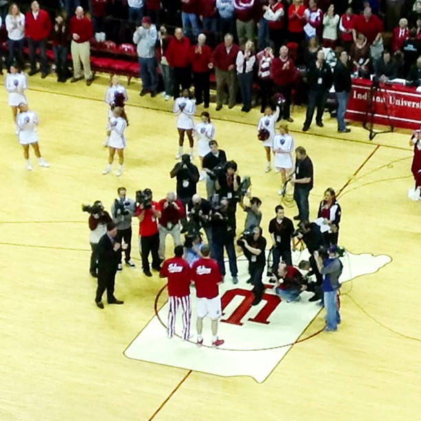 Cody Zeller and Victor Oladipo being honored at midcourt for reaching the 1,000 career point mark.