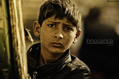Innocence (Ebtesam Ahmed) Tags: poverty new pakistan boy portrait sunlight west look canon hair justice kid eyes child poor teen sigh western teenager labour karachi