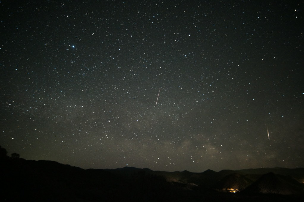 Plane in the center, meteor on the right.