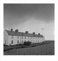 coastguard cottages (Nick Moys) Tags: beach suffolk ilfordhp5 mamiyac220 shinglestreet 55mmlens coastguardcottages moerschfinol