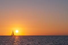 Sky Sheds Blue (brev99) Tags: ocean sunset sky sun sailboat hawaii waikiki sigma1770os
