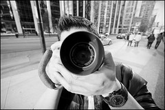 Getting way too close to NJ's nifty fifty! (Eric Flexyourhead) Tags: street camera city urban bw canada guy vancouver blackwhite friend downtown photographer bc britishcolumbia nj dude adapter burrardstreet olympusom50mmf14 legacyglass panasoniclumix714mmf40 olympusem5