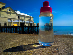 You see strange things when you don't drink enough water on a hot day! ;) (Simon Taylor Local Photographic) Tags: pier water bottle sky beach bognorregis bognor shadow refraction