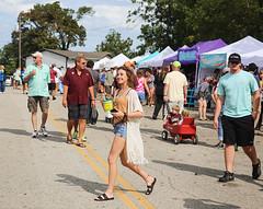 Festival Scene (wyojones) Tags: texas caldwell kolachefestival street festival peoplemen women children wagon booths stalls vendors tents caps shprts