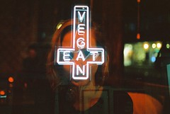 Eat Vegan (Louis Dazy) Tags: 35mm analog film double exposure neon sign eat vegan food red light dark low girl portrait