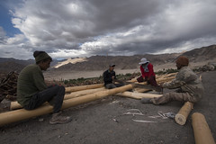 At Stakna monastery (Ravikanth K) Tags: 500px stakna monastery leh ladakh people wood cutting men work workers rebuild renovation clouds outdoor dailywork travel india jammuandkashmir log mountains hills gompa