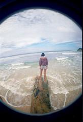 x (LiveByTheSun) Tags: ocean sky log waves dominicanrepublic fisheye