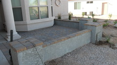Built front courtyard with pavers, pony walls, stuccoed & painted to match the home, added drip emitters to 3 pillars for potted plants. (aznativescapes) Tags: arizona wall yard landscape landscaping az patio frontyard stucco paver pavers landscaper aznativescapes
