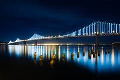 Bay Bridge Lights (bongarang) Tags: sanfrancisco california longexposure bridge water northerncalifornia night unitedstates bridges baybridge northamerica geography baybridgelights thebaylights