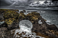 Hellnar, Iceland (Photos On The Road) Tags: travel sea beach nature water grass rock horizontal landscape outside outdoors lava coast iceland rocks europa europe mare arch outdoor stones columns noone nobody nopeople cliffs formation pietre coastal coastline roccia volcanic viaggi arco hdr highdynamicrange basalt vulcanism islanda nessuno snaefellsness outdoorshots hellnar elaborazioni basaltic orizzontale singleexposurehdr vulcanico outdoorshot snaefellspeninsula allesterno flickrsfinestimages1 bestevercompetitiongroup hdrsingoloscatto