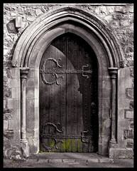 Gothic entrance (SimoLam) Tags: neglect ancient shadows decay stonecarvings churchdoor gothicarch colouraccent oldoakdoor ironhinges ornateironwork algaegrowth rottentimber