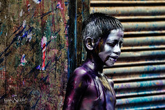 Holi (Neerod [ www.colorandlightphotography.com ]) Tags: boy color wall streak lonely holi
