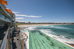 150212_0158 (amblerpix) Tags: beach pool clouds swimming sand sandstone surf day waves surfer sydney bluewater sunny australia bluesky pacificocean newsouthwales swimmers residential rockoutcrop sparklingwater northbondi residentialbuildings oceanpool icebergspool rockyforeshore icebergsclubhouse