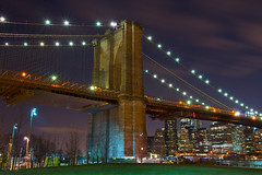 Brooklyn Bridge Lights (SunnyDazzled) Tags: park city longexposure bridge newyork tower skyline brooklyn night landscape lights colorful cityscape skyscrapers manhattan flag lawn scene flares