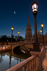 Blue hour in Sevilla (Michel Couprie) Tags: plaza bridge moon reflection tower canon river square eos sevilla spain tour place streetlamp sigma wideangle rivire reflet reflect 7d pont bluehour 1020mm espagne sville rverbre grandangle heurebleue spainsquare 100commentgroup placedelespagne blinkagain