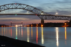 Cape Cod Canal - Explored 4/13/2013 (Whale24) Tags: longexposure sunset reflection canon reflections lights canal capecod massachusetts cape lighttrails cod capecodcanal bournebridge reflectionsinwater canont1i capecodrailroadbridge