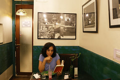 A Portrait of The Delhi Walla as Photographer Gauri Gill Reading a Book in Audrey Hepburn's Caf (Mayank Austen Soofi) Tags: delhi walla a portrait the turtle hepburn photographer gauri gill reading book neighborhood caf