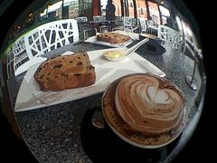 Morning Smoko (Ptolemy the Cat) Tags: samsunggalaxysmartphone fisheyelens smartphone photoshopelements posteredges food toastedraisinbread coffee cappuccino morningtea intermezzowangaratta