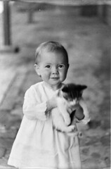 Unidentified baby girl holding kitten, c1930s, Ted Hood (State Library of New South Wales collection) Tags: statelibraryofnewsouthwales