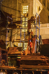 Finally Workers Remove Scaffolding At Seward Park HS LES (evening shot) (nrhodesphotos(the_eye_of_the_moment)) Tags: dsc080242300 theeyeofthemoment21gmailcom wwwflickrcomphotostheeyeofthemoment glass windows shadows light removal les sewardparkhs workers people candid metal steel brick architecture outdoors nightphoto hardhats plywood school scaffolding truck semi