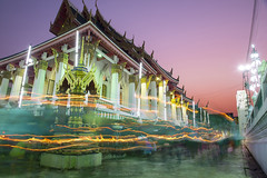 Bangkok, THAILAND - Feb 22 2016: Wat Bung Thong Lang Temple at twilight in Magha Puja day, the buddhists pray and walk with lighted candles to faith. (nattapan.suwansukho) Tags: asalha asia asian bright buddha buddhism buddhist candle dark day faith fire flame gold light night phutthamonthon pray puja religion religious ruin sensual temple thailand traditional travel worship maghapuja