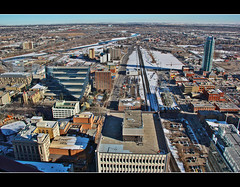 Looking South from the Calgary Tower (Explore # 253 February 11 2013) (LostMyHeadache: Absolutely Free *) Tags: trees winter sky urban snow streets calgary architecture clouds canon buildings river industrial cityscape horizon explore highrise vista distance residential calgarytower davidsmith explored calgaryalbertacanada eos60d
