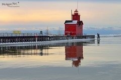 """Reflected Light"" Holland Harbor Lighthouse, known as (Big Red). (Michigan Nut) Tags: sunset sky usa lighthouse reflection landscape pier midwest michigan scenic landmark lakemichigan bigred hollandmichigan johnmccormick hollandlighthouse michigannutphotography"