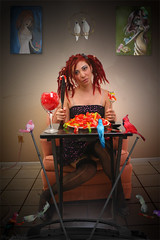 Crazy Bird Lady (Vim Trivium) Tags: food television birds dreadlocks tv model photoshoot eating gummibears paintings knife parrot fork bluebird cockatoo redhair watchingtv extensioncord gummiworms redbird birdgirl tvtray pinkbird suppertime crazybirdlady wineglas birdperch