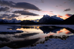 Vermilion Lakes Sunrise (Marko Stavric) Tags: park morning winter mountain lake snow canada mountains reflection water clouds sunrise rockies colours lakes rocky national alberta banff rockymountains february mountrundle vermilion rundle banffnationalpark