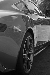 Aston Martin Vanquish (TP Photography & Design) Tags: show door camera bw 6 brown house david black slr classic monochrome beauty car clouds contrast canon silver reflections circle lens photography eos design photo paint driving exterior power angle martin d details royal automotive db sharp plush event chrome photograph frame automatic metalwork british motor 500 dslr shape tp period orientation luxury depth sleek supercar 60 alloys aston rotary astonmartin polished filling aluminium rendezvous liter 2012 litre stately refined 500d 2011 framefilling aspirated normallyaspirated