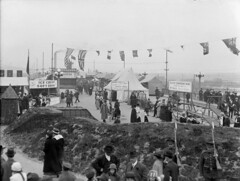 [The Georgia Viaduct closed to traffic during a carnival showing military displays and a refreshment stand]