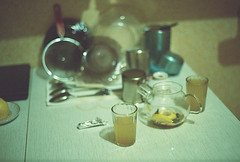 Ginger tea (Andrey Timofeev) Tags: light film home kitchen glass 35mm reflections table mugs ginger lemon shadows tea plate fork shades pot teapot dishes tones canonae1program spoons          35   ferraniasolaris400 facetedglass        february2013 canonlensfd50mm14