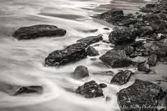 Long exposure of rocks on Bundoran Beach (linda_mcnulty) Tags: ocean longexposure ireland sea bw seascape beach water strand canon landscape rocks whitewater stones shore donegal bundoran donegalbay